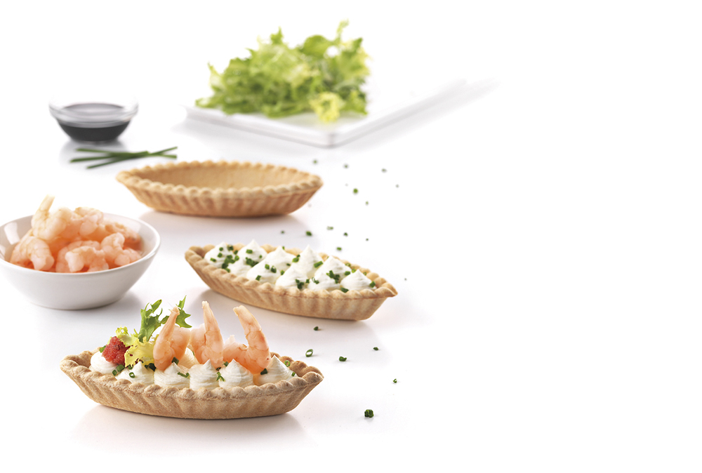 Organic boat shaped tart filled with shrimp and lumpfish roe